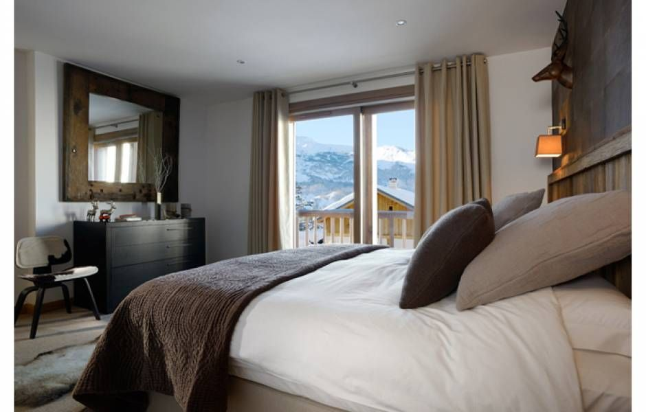Each Bedroom At Alpine Ski Lodge Features Large Windows Making
