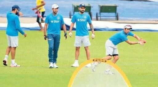 PRIMED: Gautam Gambhir (right), who returns to the Indian squad after two years, practises with the team on the eve of the second Test against New Zealand at Eden Gardens. — Photo: K.R. Deepak