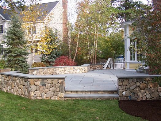 The Retaining Walls For This Raised Patio Create Beautiful Planters With  Custom Landscaping. | Retaining Walls | Pinterest | Retaining Walls,  Planters And ...