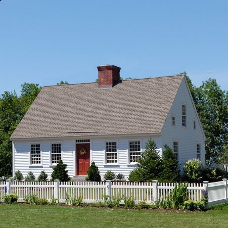 Exterior of small cape house with center chimney new for New england home builders