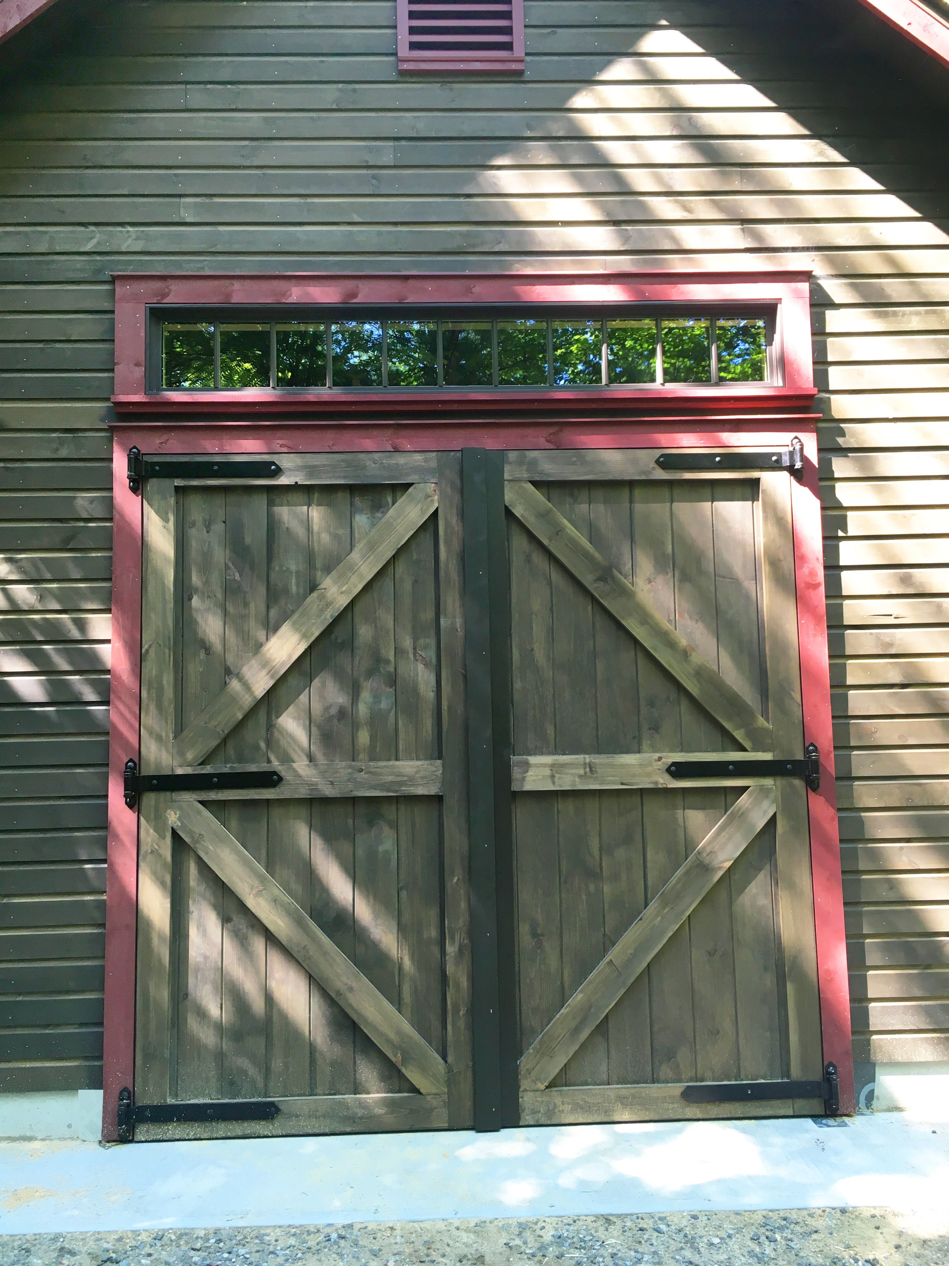 Swinging Barn Door Hardware Rustic Medium Brown Wood And Red Trim Www Rwhardware Com Richa Exterior Barn Doors Craftsman Front Doors Interior Barn Doors