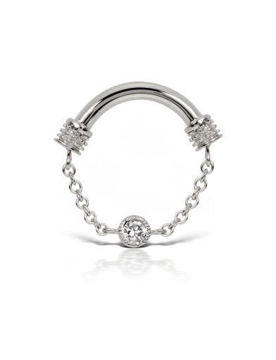 """This piece is one of our new, innovative """"Septum Spinners."""" The chains of these designs are attached to the bar and internally-threaded endcap on rotating settings, which prevents the chain from tangling. The sparkling 2mm diamond adorning the chain of this spinner rests in a scalloped-edge setting, which creates an antique and filigree effect. The back of the setting is closed, so no facial oil or makeup can occlude the diamond and it will remain brilliant."""