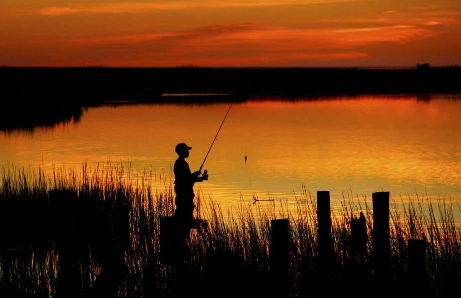A young angler fishes from the shore of Matagorda Island