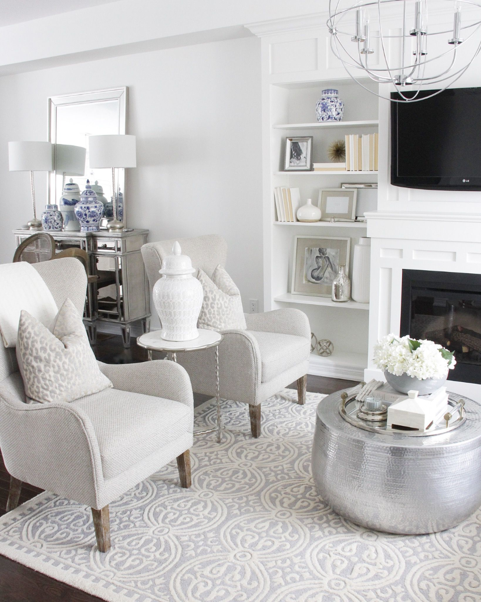 Tap to shop photo! #BuiltIns #DIYProject #Fireplace #LivingRoom #WhiteDecor #WhiteHome #WhiteLivingRoom