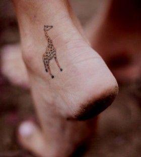 Small Giraffe Tattoo On Foot Small Giraffe Tattoo Giraffe