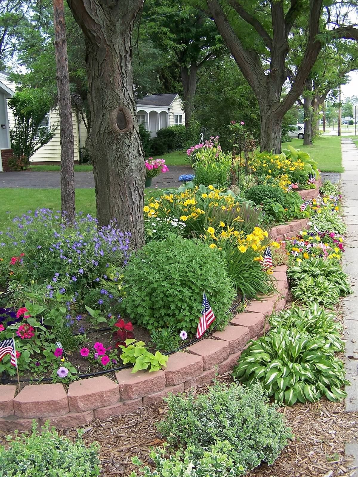 Front yard perennial flower bed my husband put in for me