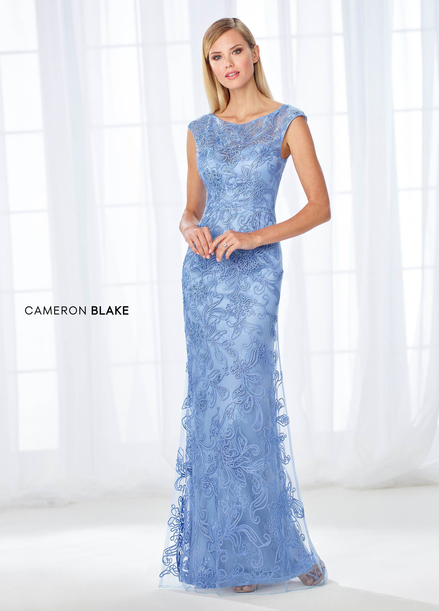 2daddb144b3b Cameron Blake 118676 - Stunning from every angle, this lace fit and flare  gown with allover ribbon work and beading features illusion cap sleeves and  a ...