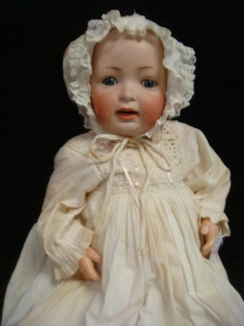 "HERTEL & SCHWAB Bisque Head Baby Doll: Marked 151 14 on Neck, Ca. 1914, 22""L. Molded, Painted Hair on Solid Bisque Head, Blue/Grey Glass Set Eyes, Open Mouth with 2 Teeth and Molded Tongue. Bent Limbs with 8 Joints. Vintage Christening Gown & Bonnet. (800-1200)"