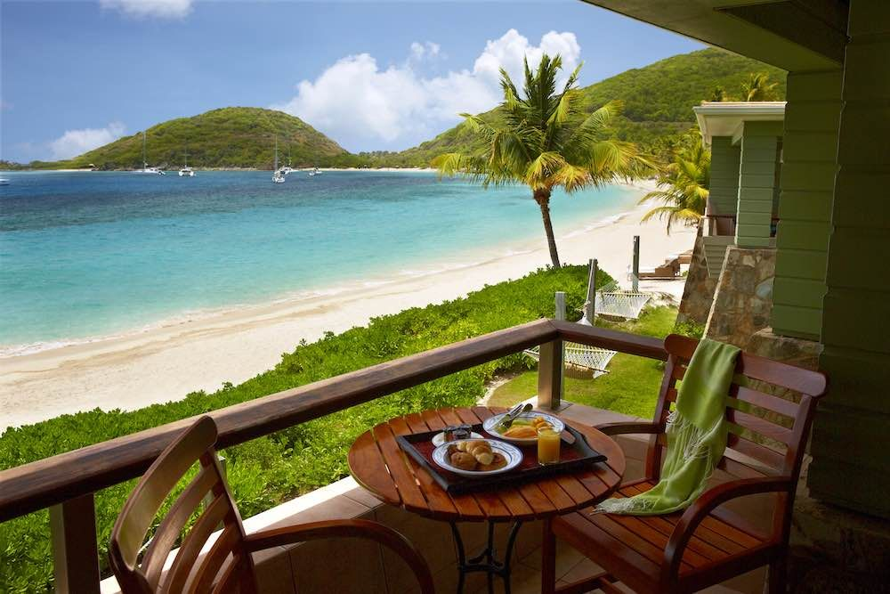 Beachfront Junior Suite Balcony at the Peter Island Resort & Spa where @5staralliance guests receive complimentary full buffet breakfast for each guest daily at Tradewinds Restaurant, VIP status,  and a $100 spa treatment credit.