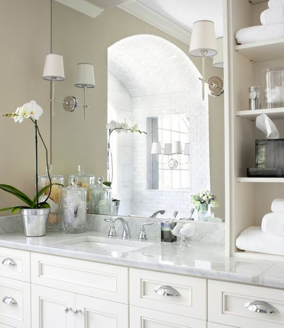 sconces mounted on mirror // shelves // details on counter