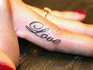since i can't wear a ring all the time want to get a tattoo on my wedding ring finger. this has been my favorite option, not the word, but the location. Todd's grandma gave me the $$ to do it a couple years ago to do this, but I keep getting pregnant! Soon though!