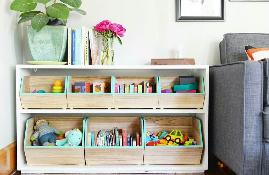 Showcasing The Books Love The Wooden Boxes From Target Love Idea Of Painting The Edges Teal To Match Her Bed Set Diy Baby Furniture Diy Toy Storage Toy Rooms