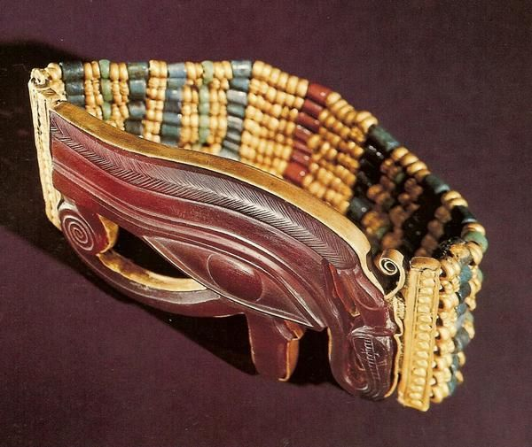 13 bracelets were placed on the forearms of Tutankhamun's mummy, 7 on the right & 6 on the left. There were other bracelets among the mummy wrappings & elsewhere in the tomb. This bracelet was placed on the right forearm, near the elbow. Its band is composed of 9 rows of gold, faience, & glass beads threaded between 6 gold spacer bars that resemble the gold beads &  keep the 9 rows in position. The clasp is like a pegged mortise.