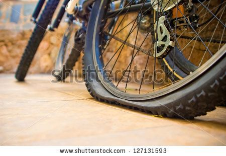 Two Bicycles At The Yard One With A Flat Tyre Image Id 127131593 Copyright Saap585 Bike Tire Bike Repair Bicycle