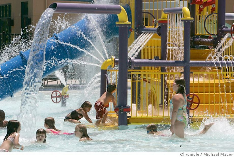 LIVERMORE  family14_136_mac.jpg Kids swarm the play structure area with loads of different water jets. Robert Livermore Community Center Aquatics in Livermore. For a feature on 96 Hours' family page, we spotlight 3 really cool pools to spend a summer day. Photographed in, Livermore, Ca, on 6/9/07. Photo by: Michael Macor/ The Chronicle Photo: Michael Macor