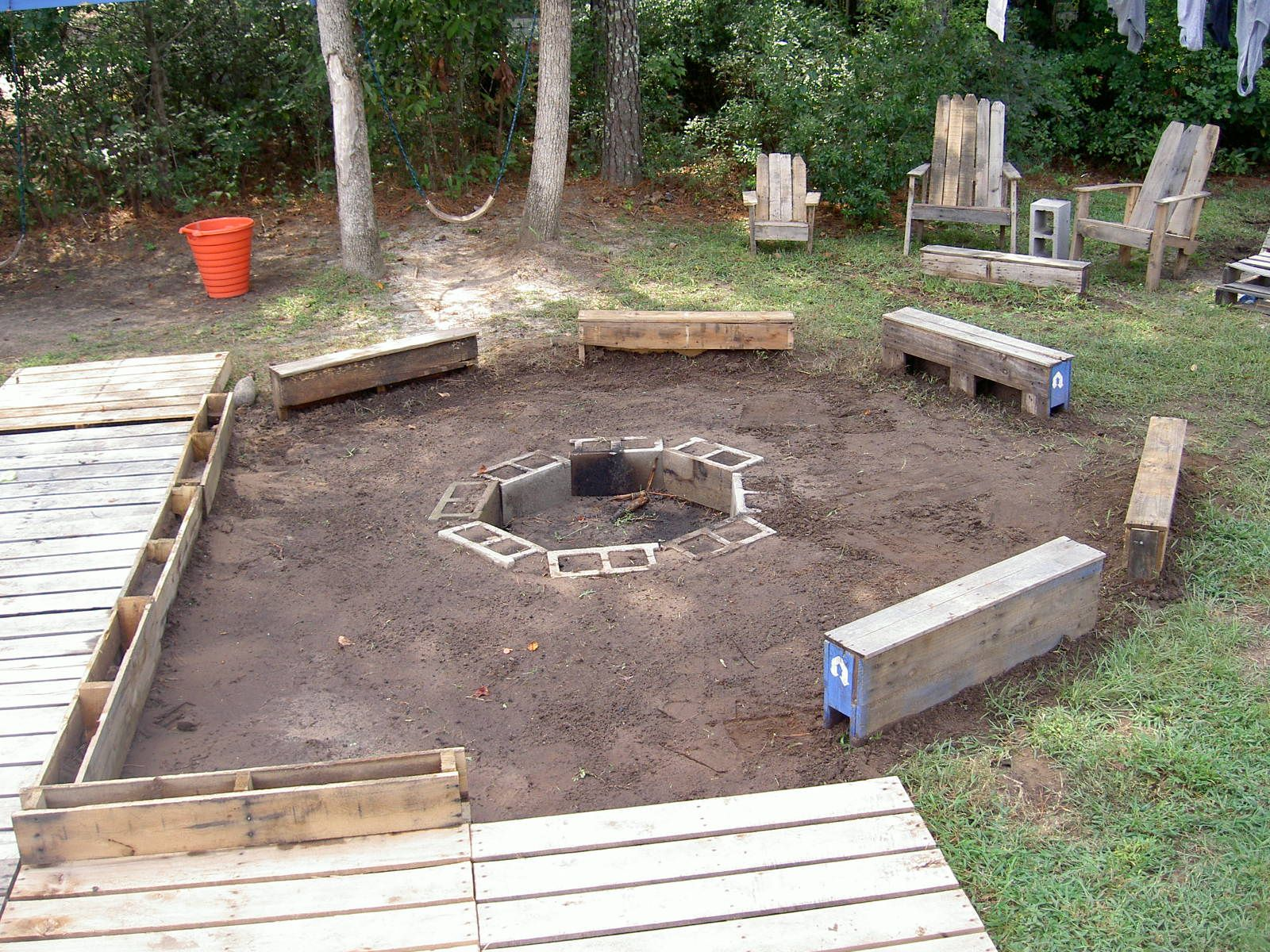 Fire pit deck and seats as well as the adirondack chairs for Decking made from pallets