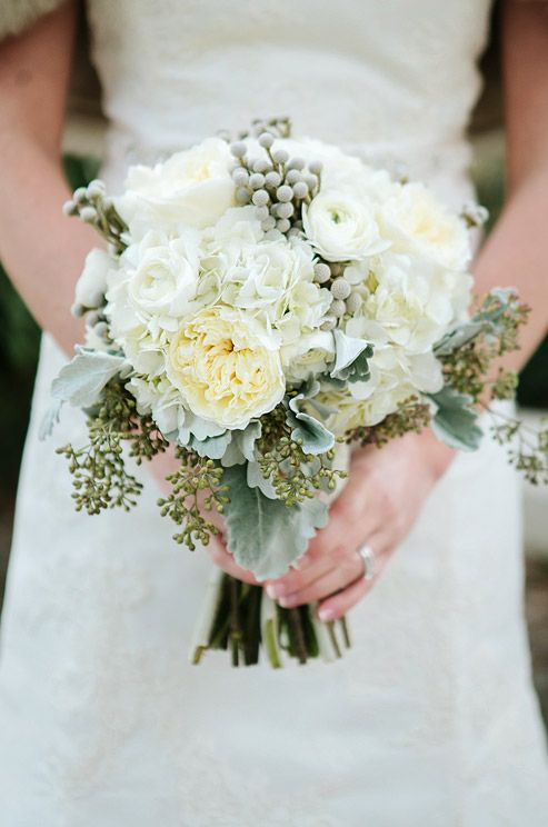 Ranunculus, dusty miller and roses make up this bride\'s beautiful ...