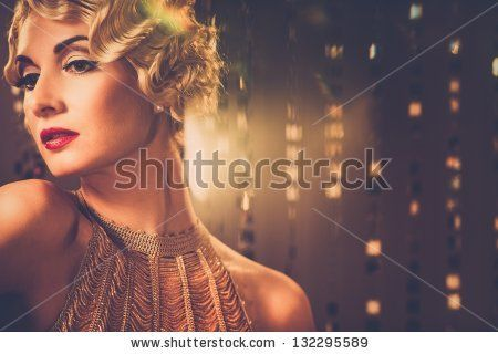 Elegant blond retro woman  in golden dress with beautiful hairdo and red lipstick by Nejron Photo, via ShutterStock