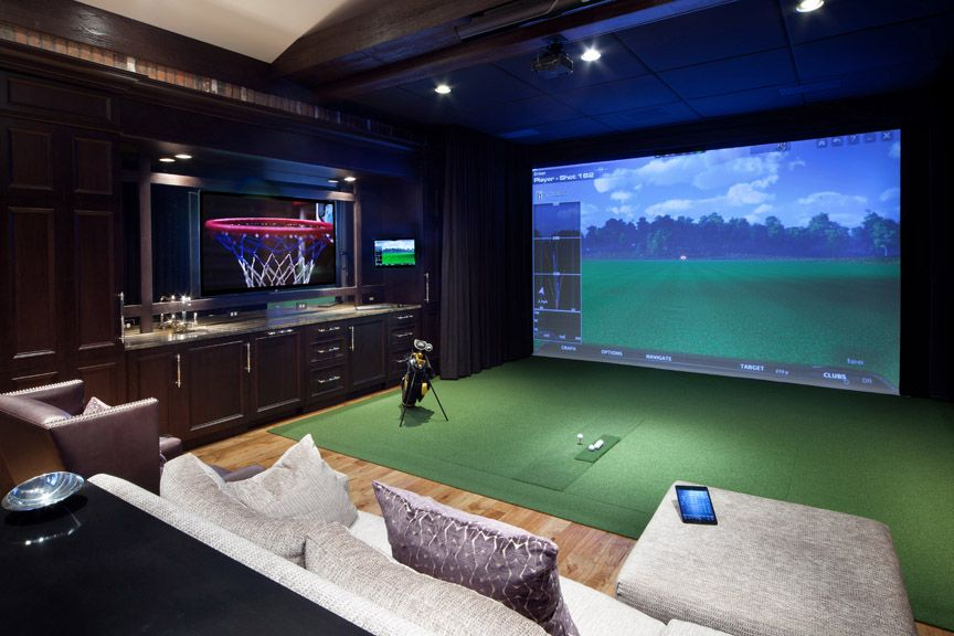 Media Room With Multiple Screens And Golf Simulation Setup