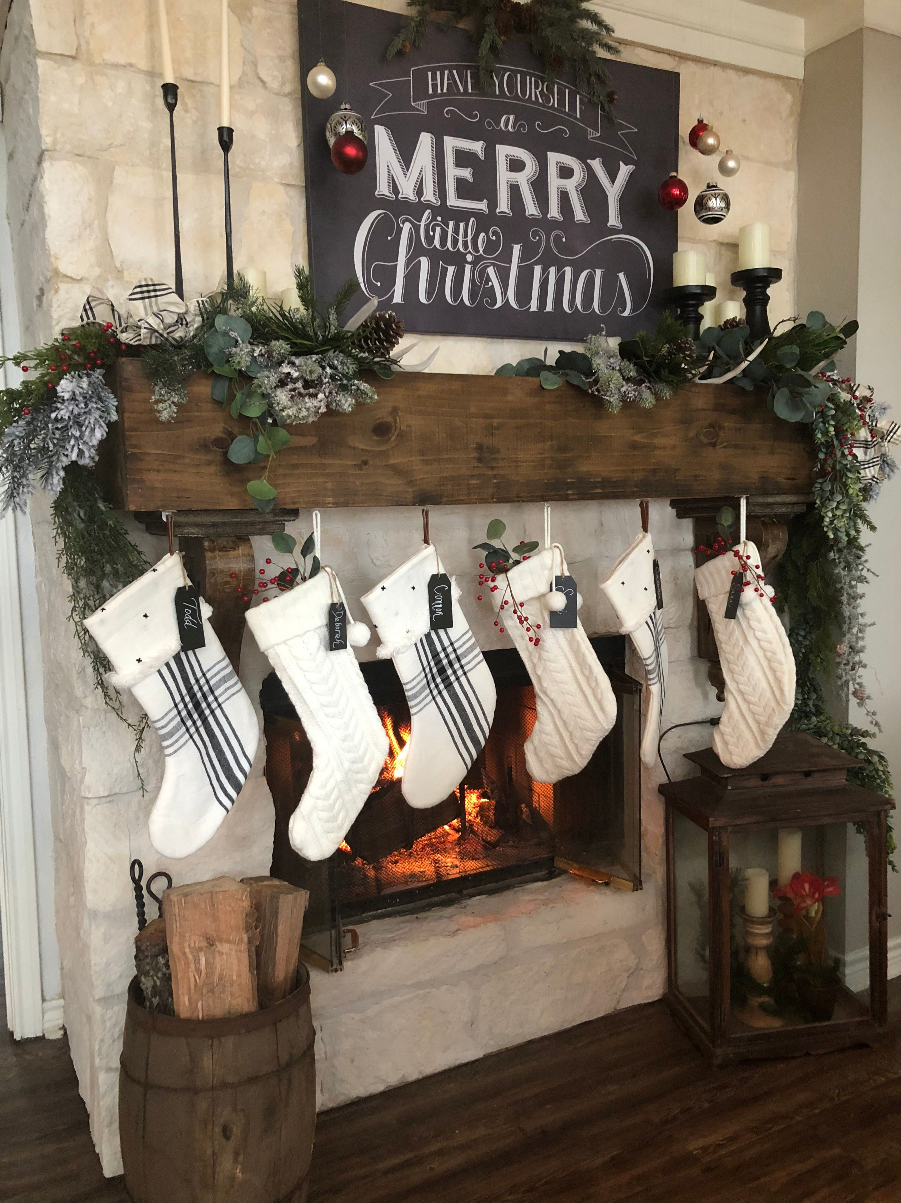 Love this mantle decorated for Christmas. I also like the small round wood barrel on the left that is filled with wood for the fireplace... I have one of these barrels :)