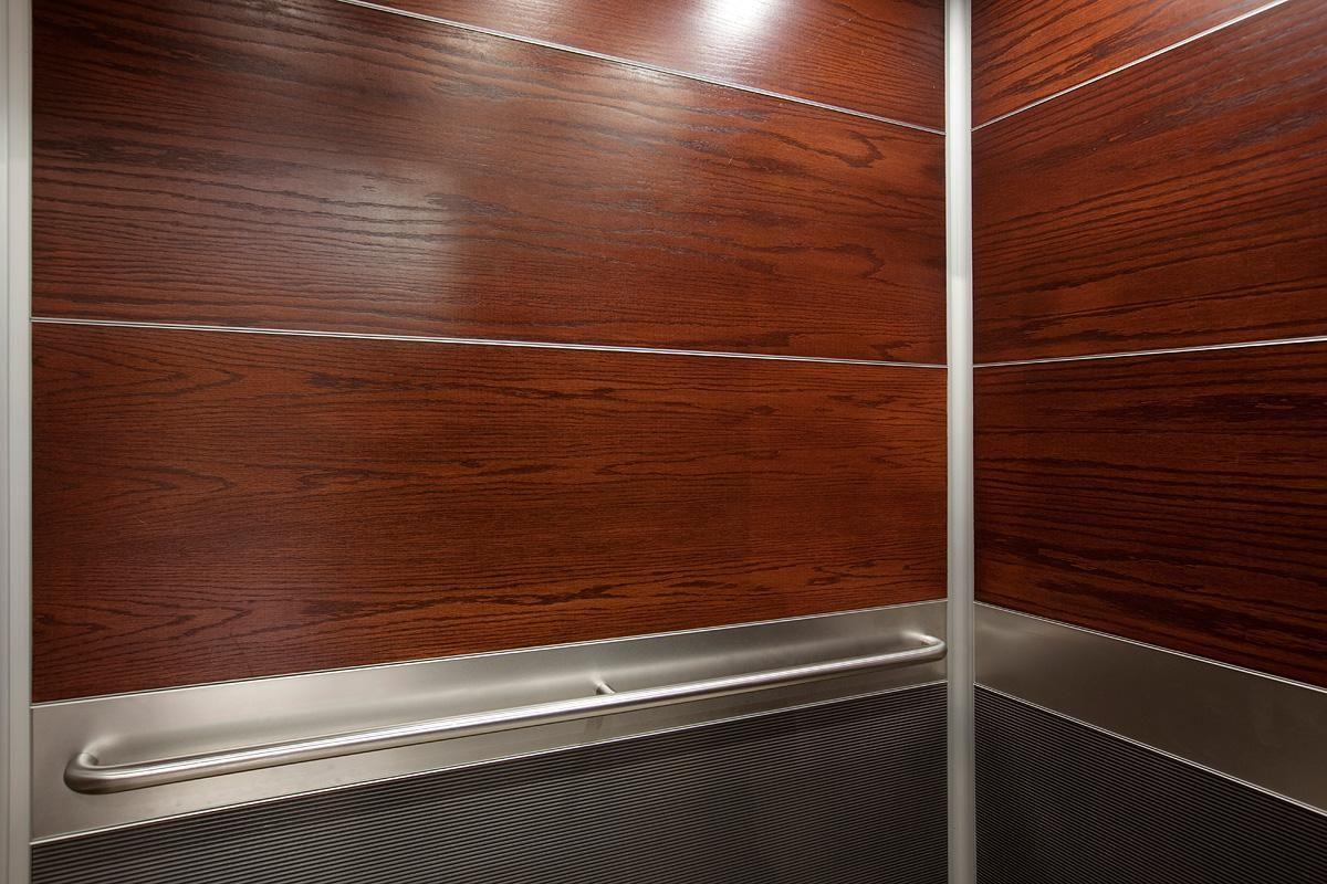 LEVELe-104 Elevator Interior with upper panels in custom wood veneer; lower  panels in - LEVELe-104 Elevator Interior With Upper Panels In Custom Wood