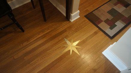 brass star floor inlay home  design elemets