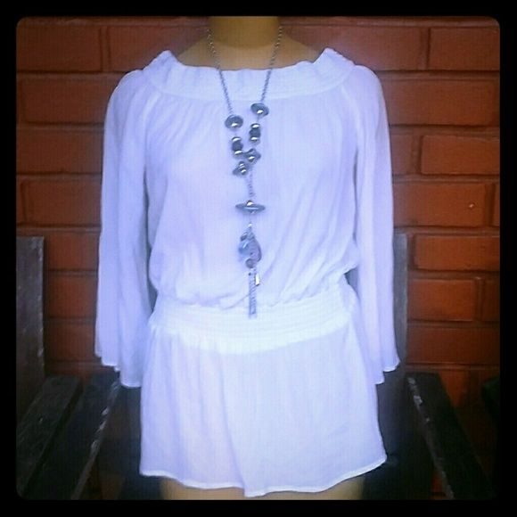 Forever 21 white blouse NEW Never worn still has tag. 100% rayon. Very cute with elastic waist. Forever 21 Tops Blouses