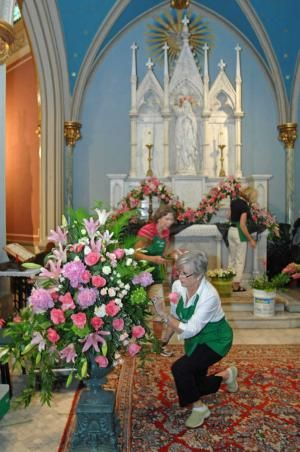 Cathy Belford of St. John Episcopal Church works on a floral arrangement at the Cathedral of St. John the Baptist for the festival of flowers in honor of Brother Robert Sokolowski's 70th birthday. (John Carrington/Savannah Morning News)