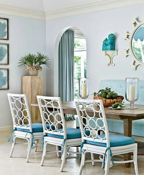Pretty, casual dining room~ Colors are teal and white and have a beachy theme~very