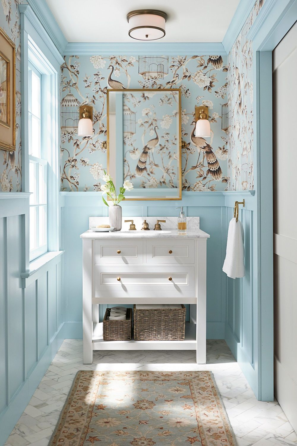 a serene spalike powder room with classic white console