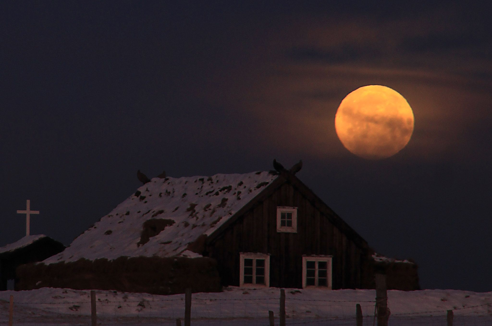 Full moon over an old turf church, Árbæjarsafn, Iceland