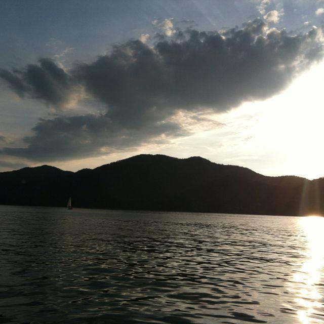 Sailboat, sun & clouds