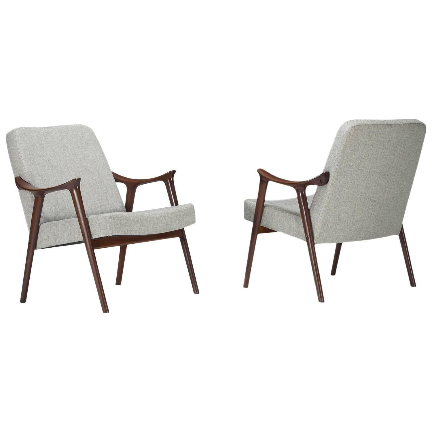 Lounge Chairs Pair by Rolf Rastad and Adolf Relling. I inherited a similar chair...thinking I may need to have it restored.