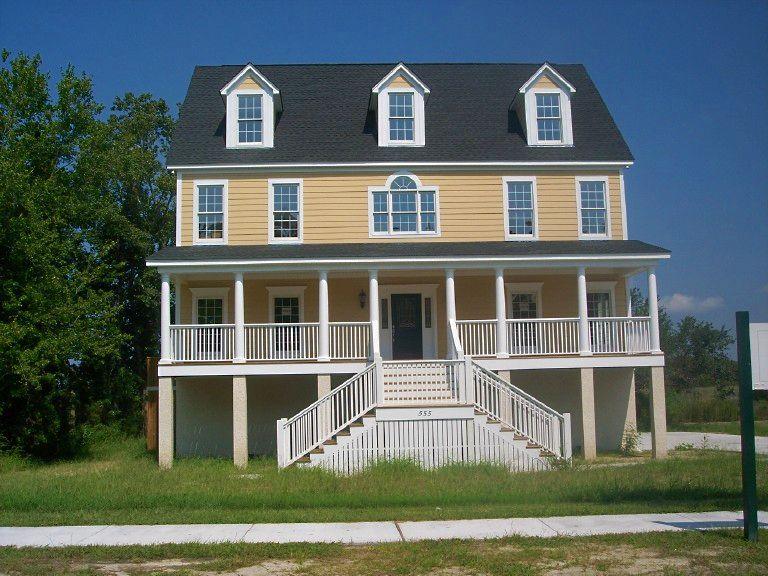 Two story coastal modular home design built on a pier foundation ...