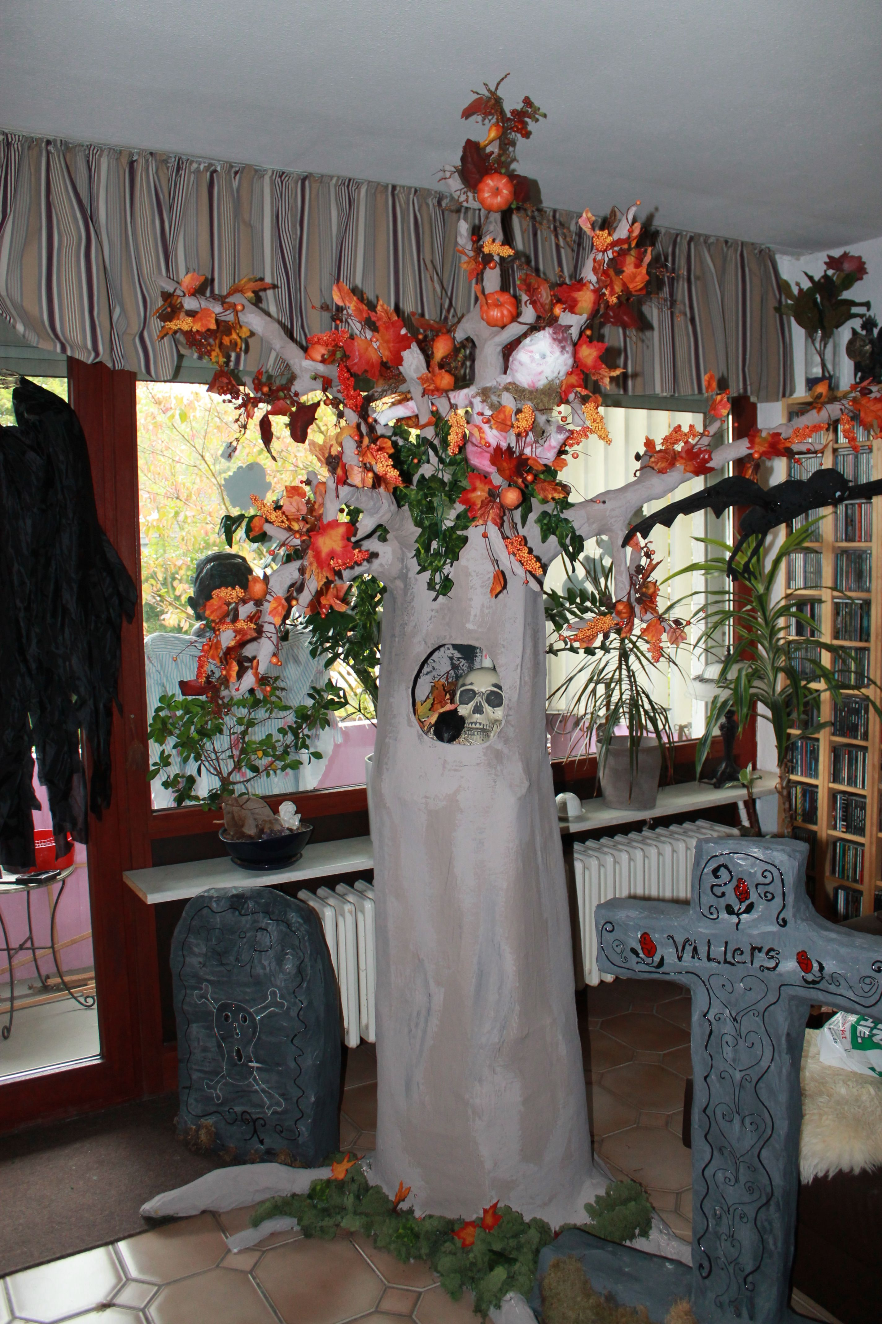 My tree when done.. I added decoration for Halloween. I added a mummy in the tree and some fall leafs..