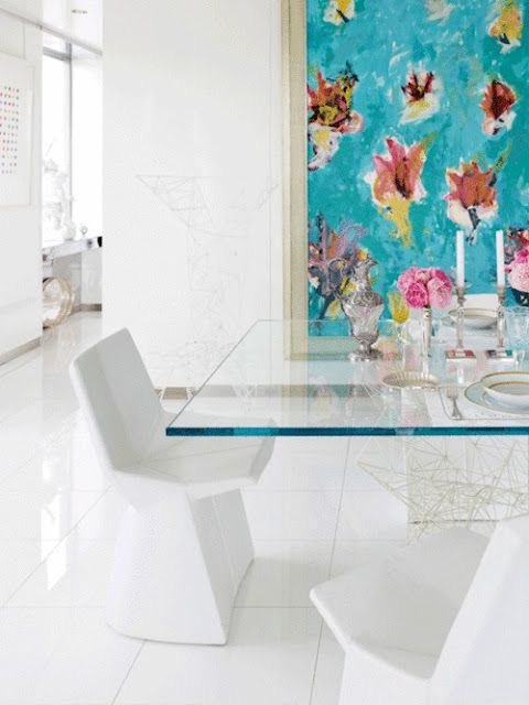 Don't Eat, Dine! All white with a clear pedestal dining table and a Damien Hirst.