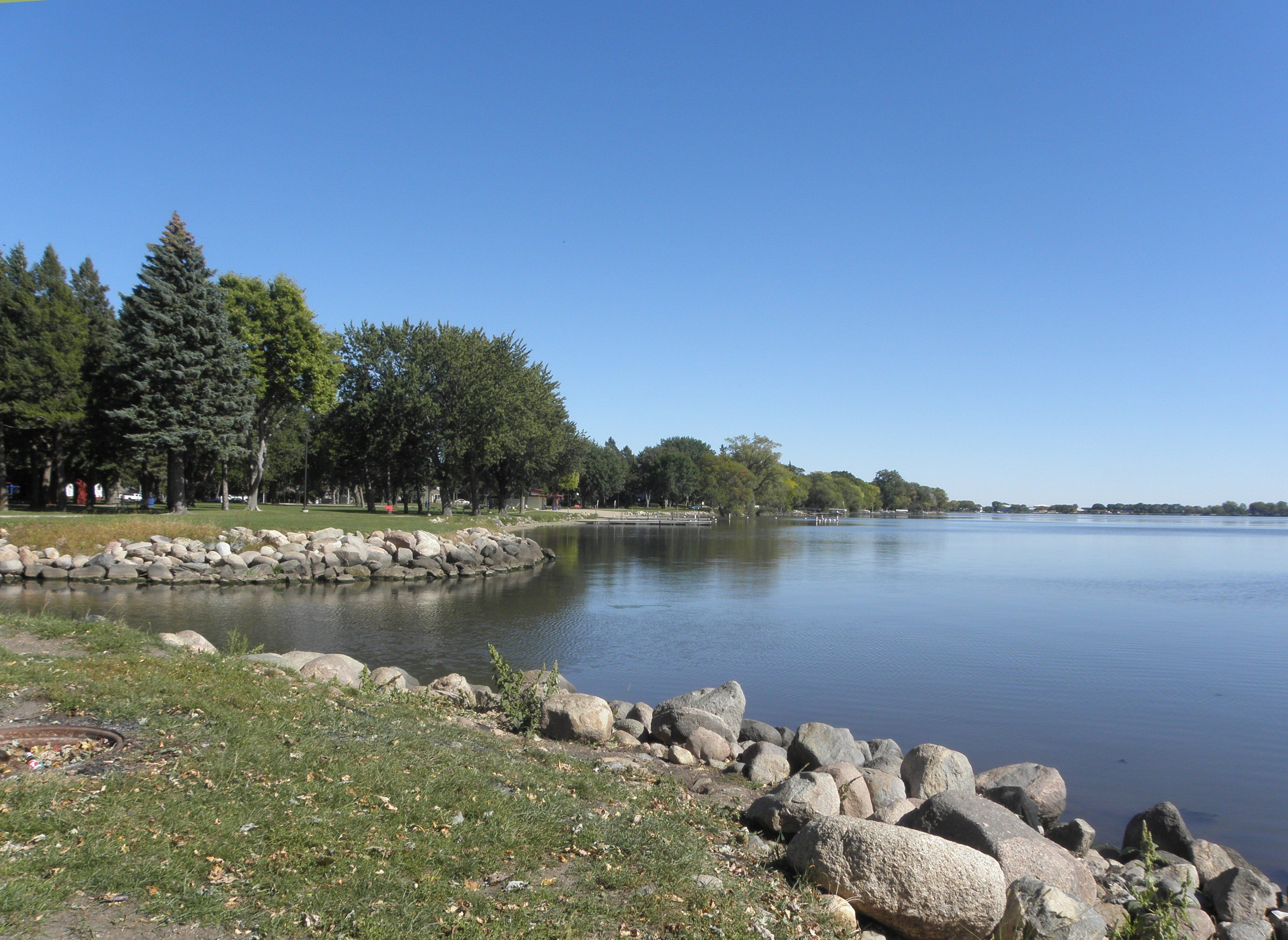 Centennial Park area looking accross outlet from Whiskey Ditch towards the East on North side of Lake Okabena in Worthington, MN