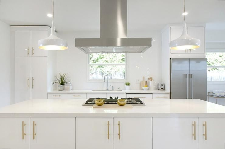 White And Gold Kitchen With Long Brushed Brass Pulls Contemporary Kitchen White Kitchen Handles Gold Kitchen Contemporary Kitchen