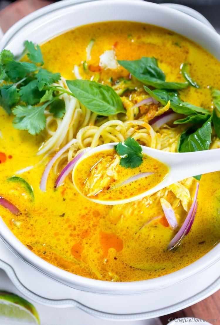 Chicken Khao Soi This Yellow Curry Noodle Soup recipe is bursting with flavor of coconut curry. Serve it with fresh zucchini noodles for a low-carb Noodle Soup dinner.  #lowcarb #zucchini #chicken #soup