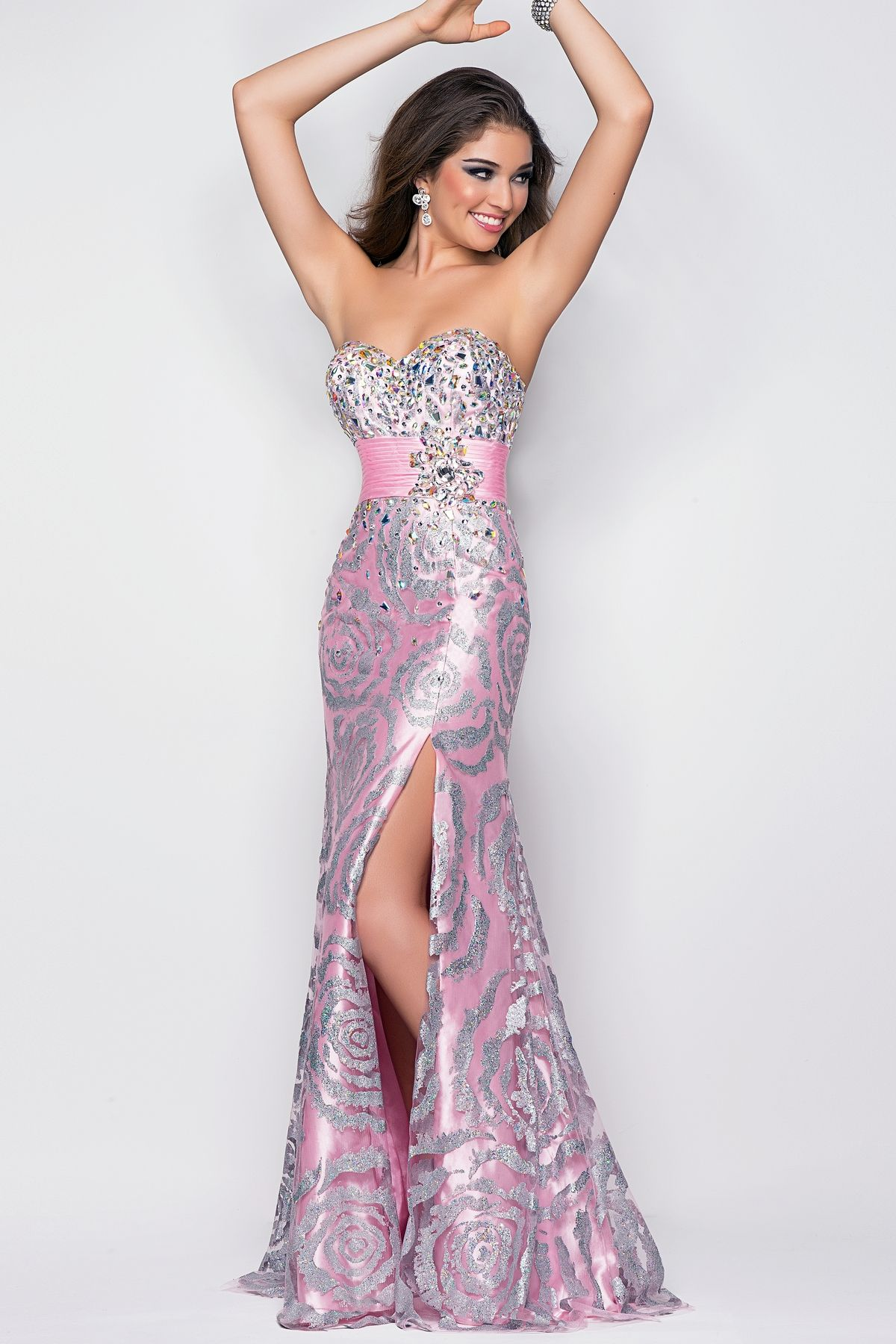 Beaded swirl drama in a formal prom dress this powerful gown flows