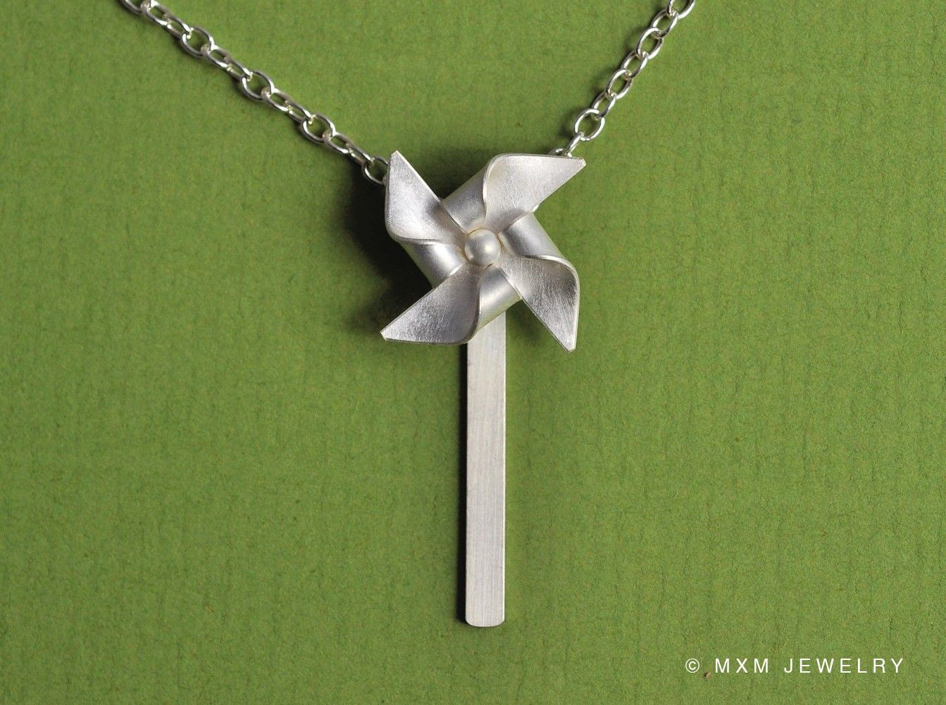 Tiny Pinwheel (windmill) Necklace II. $48.00, via Etsy.