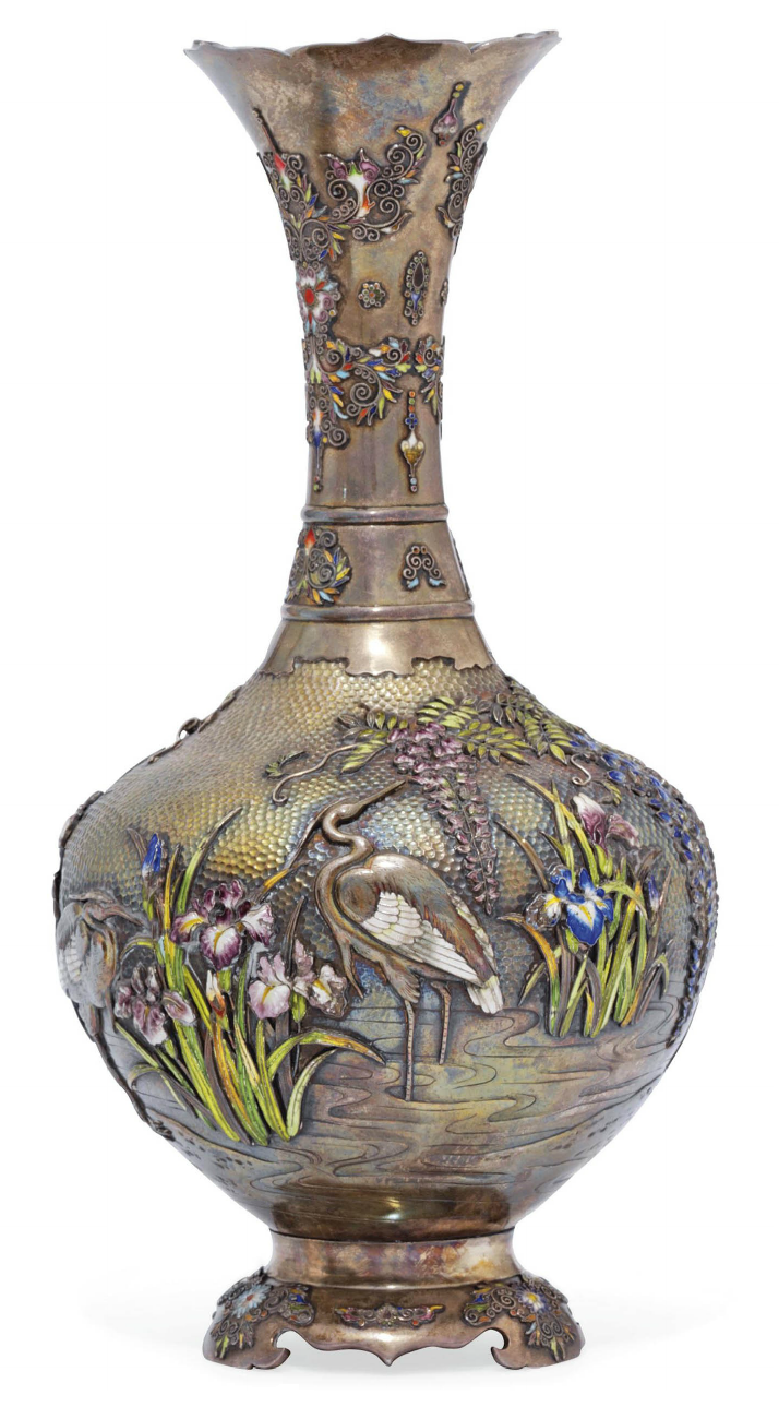 A Silver and Cloisonné Vase  Signed Yoshihide, Meiji Period (late 19th century)  The surface hammered, chased, engraved and inlaid in various coloured cloisonné enamels with a heron in a stream with irises and hanging wisteria, the neck and foot with flowers and scrolling foliage