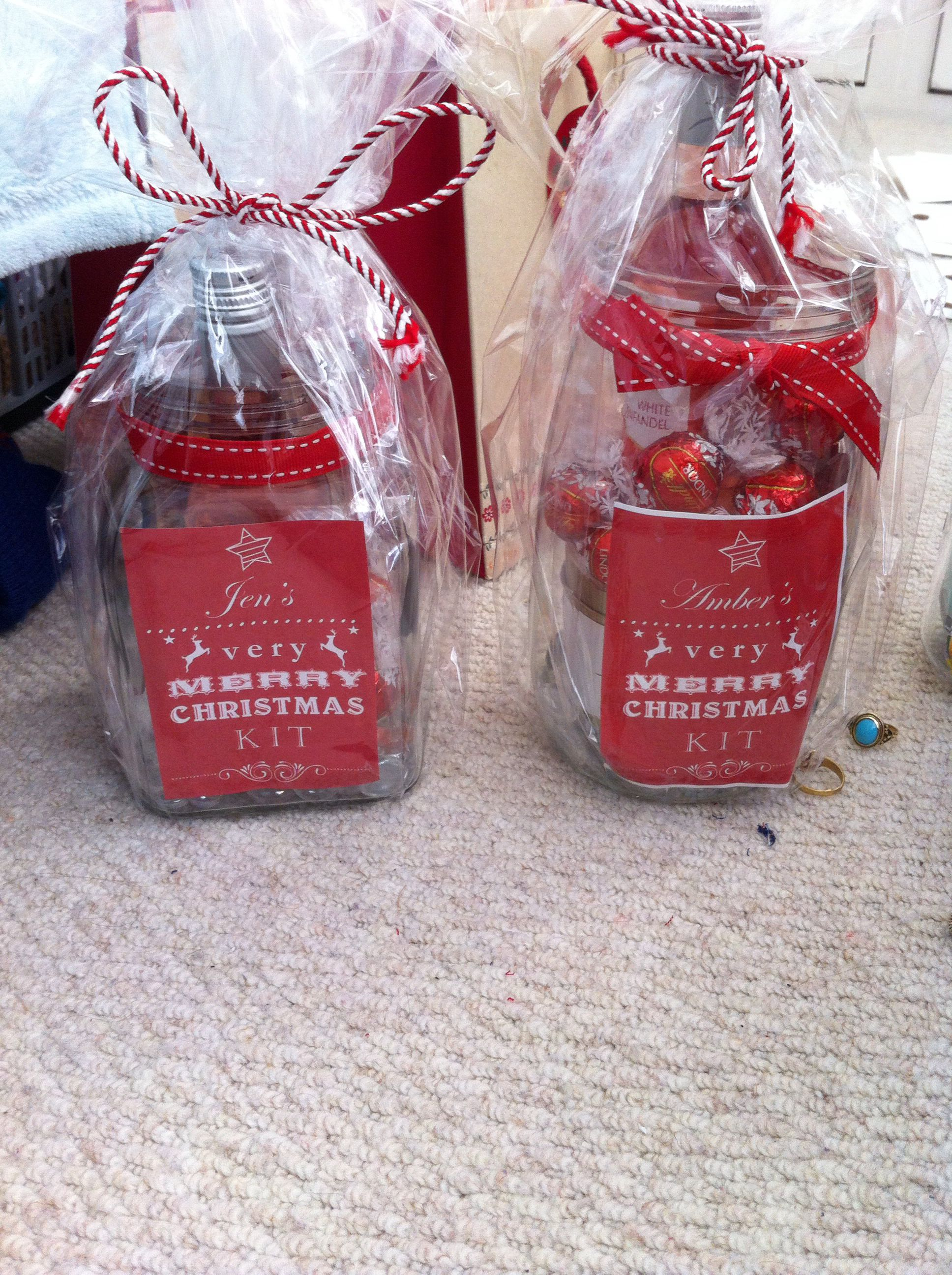 Cute Christmas Gift Idea Jars Filled With Wine Chocolates Candle Hand Cream And Wrapped In Cellophane With Homema Cute Christmas Gifts Jar Gift Wrapping