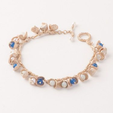 Itty Bitty Shell Bracelet by Michael Michaud. I could buy every item of his!