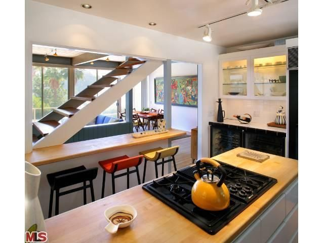 open plan staircase in living room paint colors for walls ideas love the stairs middle of kitchen this exact idea i was looking to