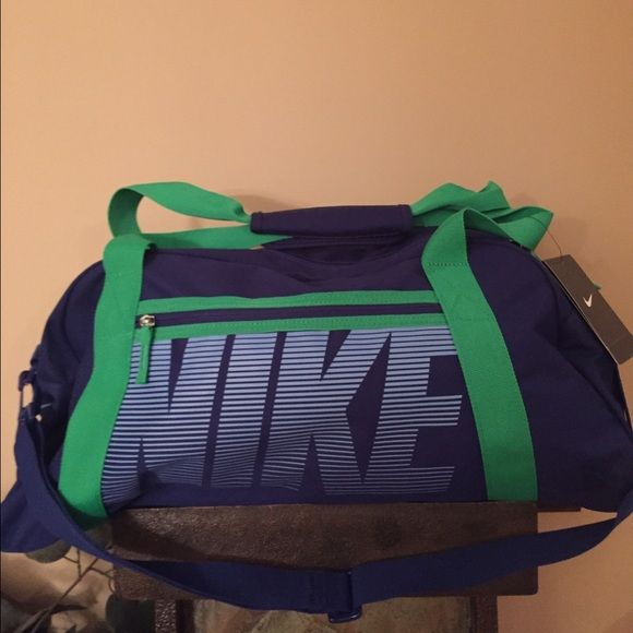9ef765a16e NWT s Nike duffle bag with shoulder strap. NWT s Women Nike Gym bag. Blue  and green. Medium size approx. 1