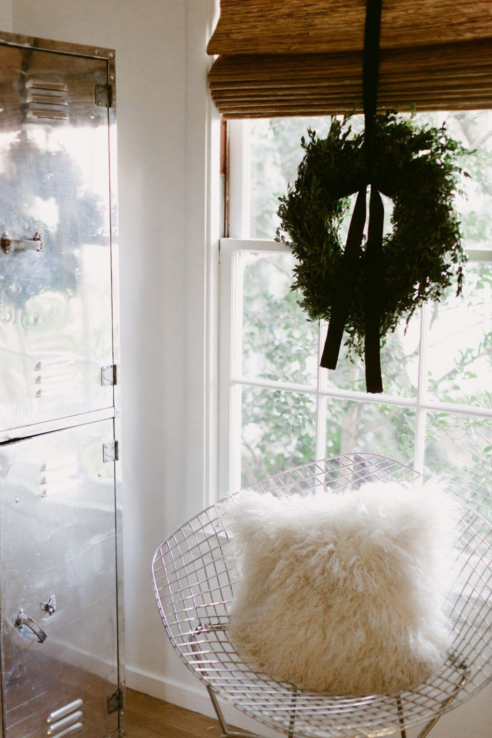 boxwood wreaths in the windows