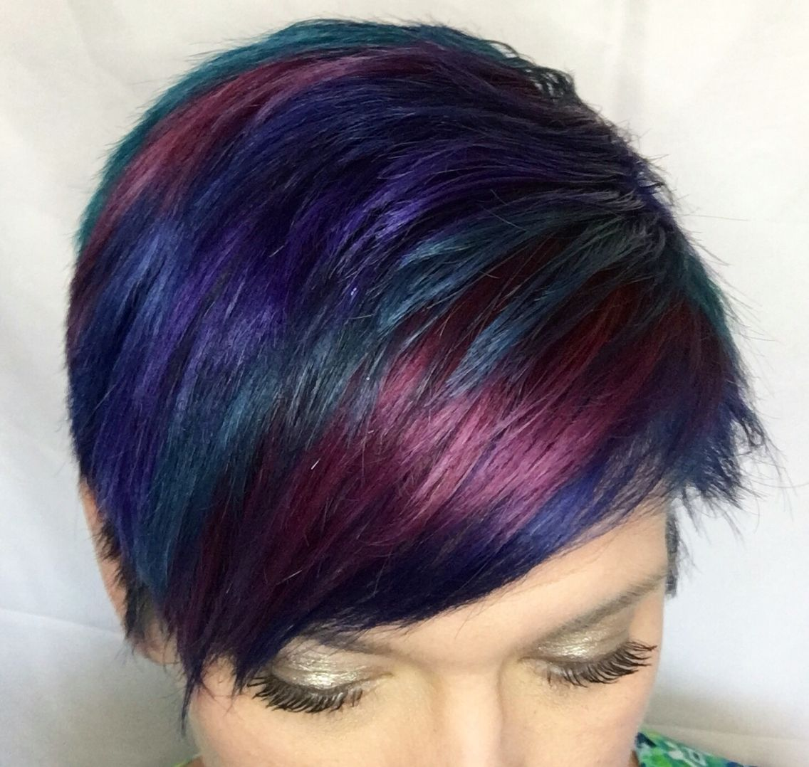 Dark blue red purple and green pixie with ion color brilliance