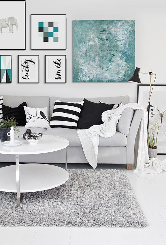 Tavlor ovanför soffa. Canvastavla och prints i ram