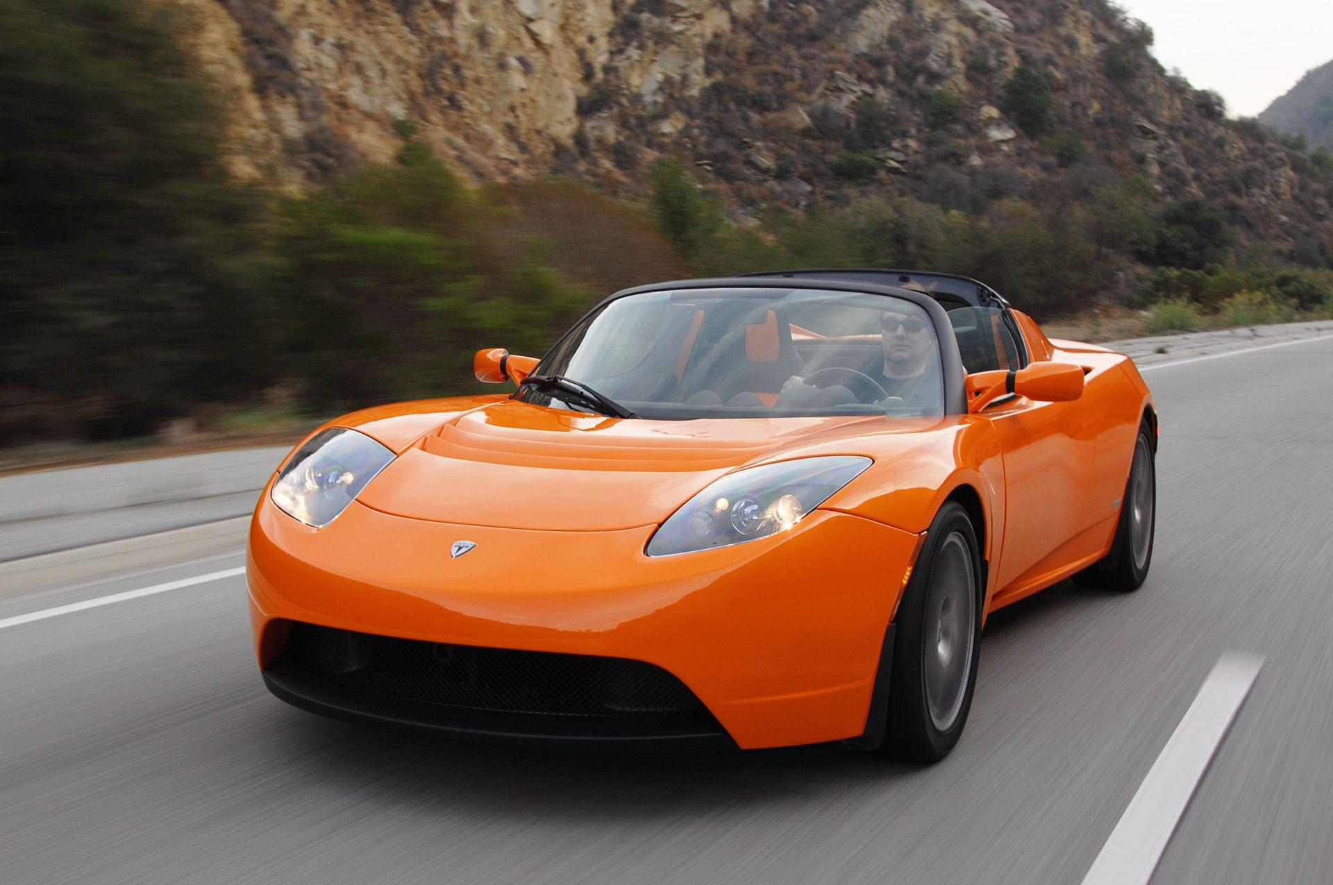 2008 Orange Tesla Roadster Tesla roadster, Electric